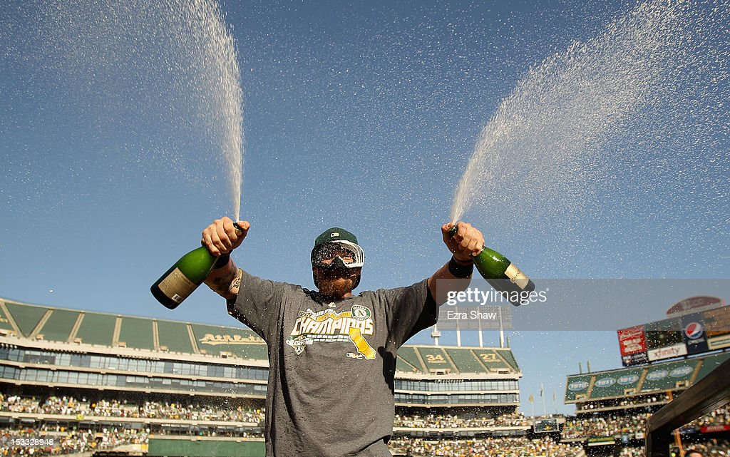 Jonny Gomes #31 of the Oakland Athletics celebrates after they beat the Texas Rangers to win the American League West Division Title at O.co Coliseum on October 3, 2012 in Oakland, California.