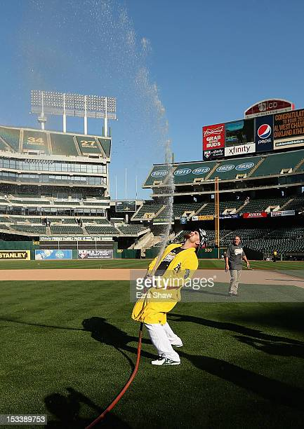 Jonny Gomes of the Oakland Athletics celebrates after they beat the Texas Rangers to win the American League West Division Title at Oco Coliseum on...