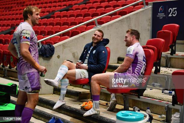 Jonny Gray of Exeter Chiefs talks with Finn Russell of Racing 92 and Stuart Hogg of Exeter Chiefs following the Heineken Champions Cup Final between...