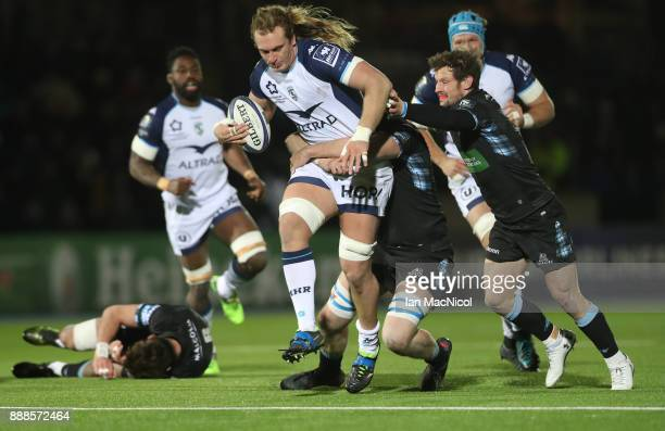 Jonny Gray of Glasgow Warriors tackles Jacques Du Plessis of Montpellier during the European Rugby Champions Cup match between Glasgow Warriors and...