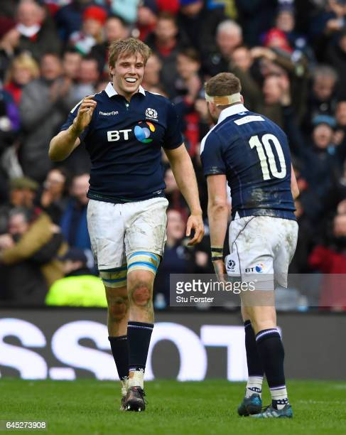 Jonny Gray of Scotland and Finn Russell of Scotland celebrate following their team's 2913 victory during the RBS Six Nations match between Scotland...