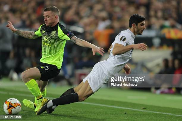 Jonny Hayes of Celtic tackles Goncalo Guedes of Valencia during the UEFA Europa League Round of 32 Second Leg match between Valencia v Celtic at...