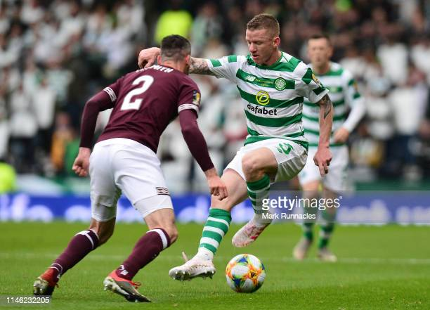 Jonny Hayes of Celtic takes on Michael Smith of Hearts during the Scottish Cup Final between Heart of Midlothian FC and Celtic FC at Hampden Park on...