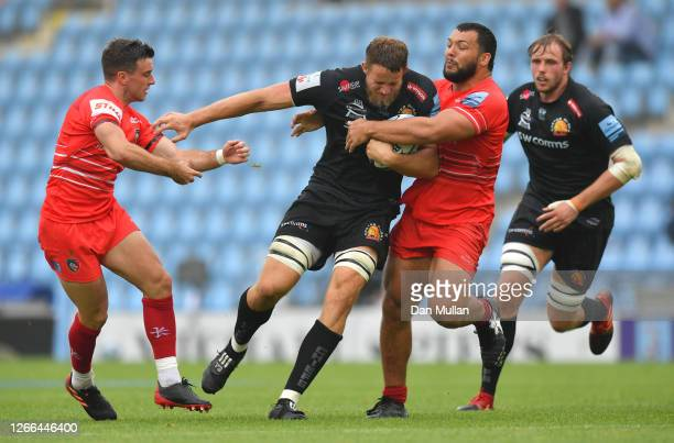 Jonny Hill of Exeter Chiefs is tackled by George Ford of Leicester Tigers and Ellis Genge of Leicester Tigers during the Gallagher Premiership Rugby...