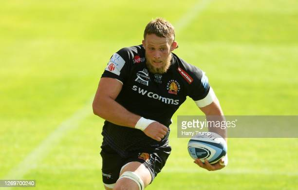 Jonny Hill of Exeter Chiefs runs with the ball before going in to score his sides six try during the Gallagher Premiership Rugby match between Exeter...