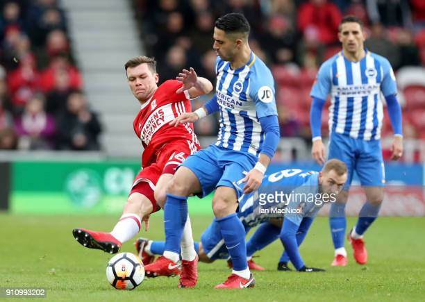 Jonny Howson of Middlesbrough and Biram Kayal of Brighton and Hove Albion battle for the ball during The Emirates FA Cup Fourth Round match between...