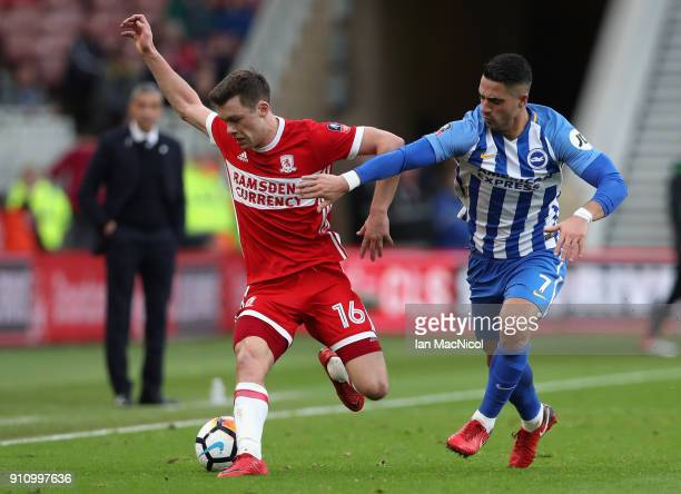 Jonny Howson of Middlesbrough is challenged by Biram Kayal of Brighton and Hove Albion during The Emirates FA Cup Fourth Round match between...