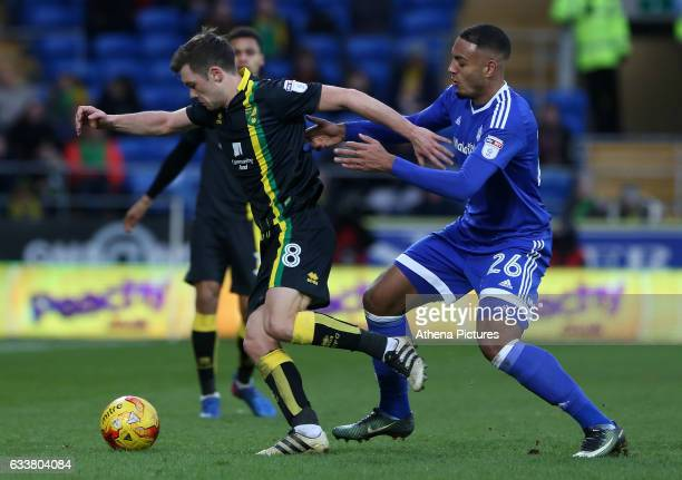 Jonny Howson of Norwich City is challenged by Kenneth Zohore of Cardiff City during the Sky Bet Championship match between Cardiff City and Norwich...