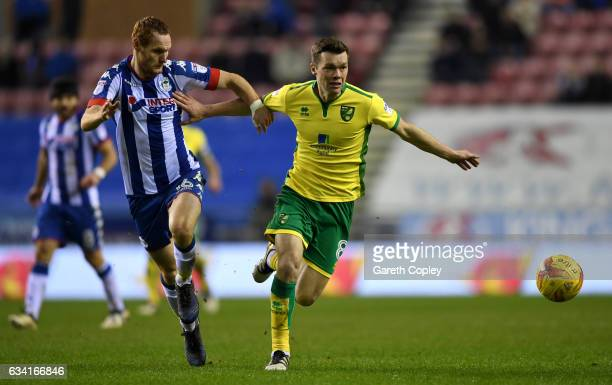 Jonny Howson of Norwich holds off Shaun MacDonald of Wigan during the Sky Bet Championship match between Wigan Athletic and Norwich City at DW...