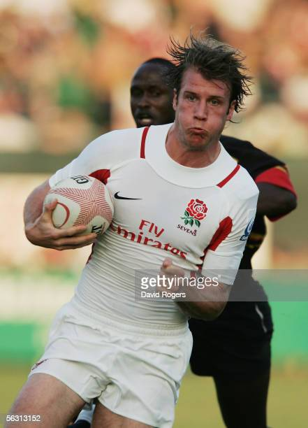 Jonny Hylton of England races away to score a try in the match against Uganda during the Emirates IRB 7's at the Dubai Exiles Rugby Ground on...