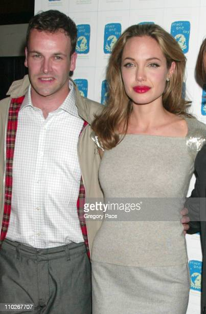Jonny Lee Miller and Angelina Jolie during ''Peace One Day'' New York City Screening Inside Arrivals and Green Room at Ziegfeld Theater in New York...