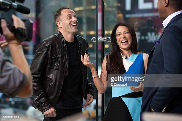 "Jonny Lee Miller and Lucy Liu visit ""Extra"" at their New York studios at H&M in Times Square on October 10, 2014 in New York City."