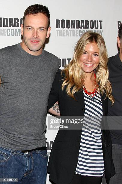 Jonny Lee Miller and Sienna Miller attend the 'After Miss Julie' Broadway cast photo call on September 8 2009 in New York City