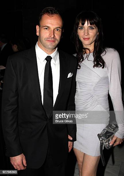 Jonny Lee Miller and wife Michele Hicks pose at the opening night party for After Miss Julie on Broadway at Espace on October 22 2009 in New York City
