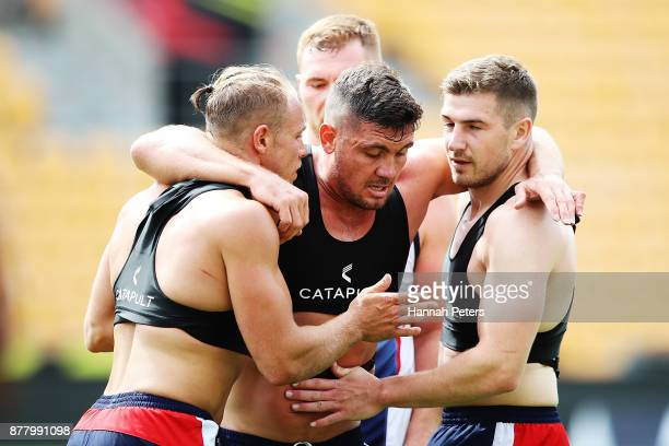 Jonny Lomax Chris Heighington and George Williams run through fitness drills during the England Rugby League World Cup Semi Final Captain's Run at Mt...