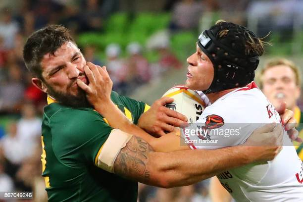 Jonny Lomax of England is tackled by Matt Gillett of the Kangaroos during the 2017 Rugby League World Cup match between the Australian Kangaroos and...