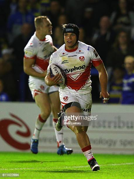 Jonny Lomax of St Helens breaks through to score their first try during the First Utility Super League Semi Final match between Warrington Wolves and...