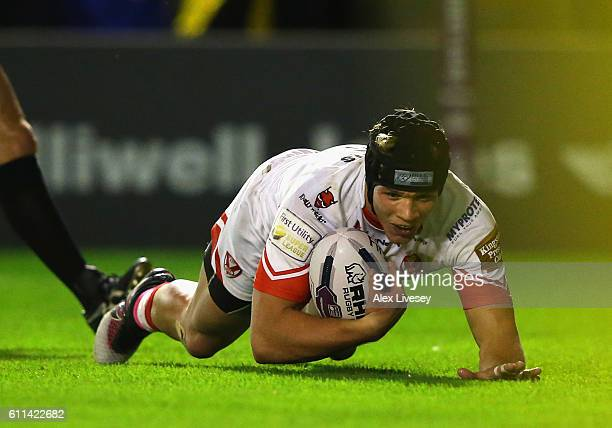 Jonny Lomax of St Helens dives over the line to score their first try during the First Utility Super League Semi Final match between Warrington...