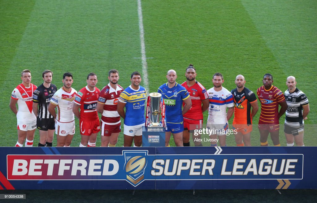 Jonny Lomax of St Helens, Joe Mellor of Widnes Vikings, Ben Garcia of Catalans Dragons, Shaun Lunt of Hull KR, Sean O'Loughlin of Wigan Warriors, Ryan Hall of Leeds Rhinos, Chris Hill of Warrington Wolves, Manu Vatuvei Salford Red Devils, Tyler Randall of Wakefield Trinity, Luke Gale of Castleford Tigers, Jermaine McGillvary of Huddersfield Giants and Danny Houghton of Hull FC pose with the Super League Trophy during the Super League 2018 Season Launch the at John Smith's Stadium on January 25, 2018 in Huddersfield, England.