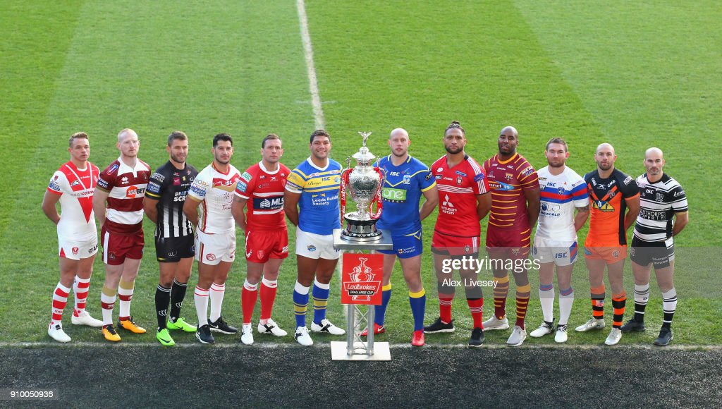 Jonny Lomax of St Helens, Liam Farrell of Wigan Warriors, Rhys Hanbury of Widnes Vikings, Ben Garcia of Catalans Dragons, Shaun Lunt of Hull KR, Ryan Hall of Leeds Rhinos, Chris Hill of Warrington Wolves, Manu Vatuvei Salford Red Devils, Michael Lawrence of Huddersfield Giants, Tyler Randall of Wakefield Trinity, Luke Gale of Castleford Tigers and Danny Houghton of Hull FC pose with the Challenge Cup during the Super League 2018 Season Launch the at John Smith's Stadium on January 25, 2018 in Huddersfield, England.