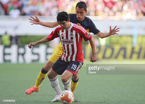 Jonny Magallon of Chivas and Paul Aguilar of America struggle for the ball during a match between Chivas and America as part of the Torneo Clausura...