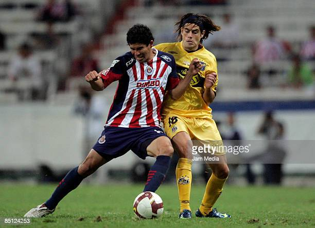 Jonny Magallon of Chivas Guadalajara and Ezequiel Miralles of Everton Chile during their Copa Libertadores 2009 match on February 25 in Guadalajara...