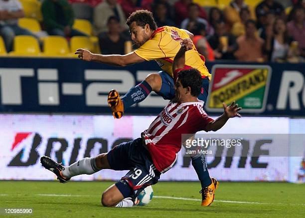 Jonny Magallon of Chivas struggles for the ball with Miguel Sabah of Morelia during their match as part of the Apertura 2011 at the Morelos Stadium...