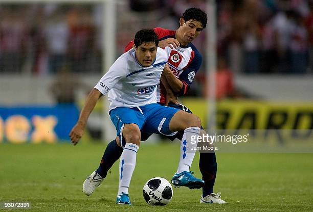 Jonny Magallon of Chivas vies for the ball with Javier Orozco of Cruz Azul during their match as part of the 2009 Opening tournament the closing...