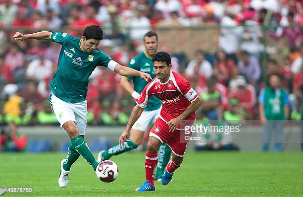 Jonny Magallon of Leon and Antonio Naelson of Toluca fight for the ball during a match between Toluca and Leon as part of the Torneo Apertura 2012 at...