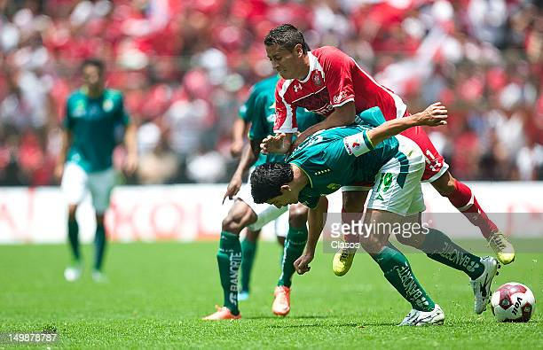 Jonny Magallon of Leon and Carlos Esquivel of Toluca fight for the ball during a match between Toluca and Leon as part of the Torneo Apertura 2012 at...