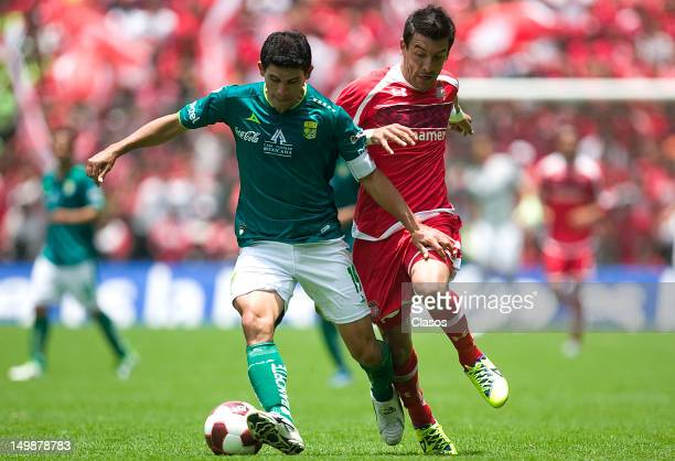 Jonny Magallon of Leon and Edgar Benitez of Toluca fight for the ball during a match between Toluca and Leon as part of the Torneo Apertura 2012 at...