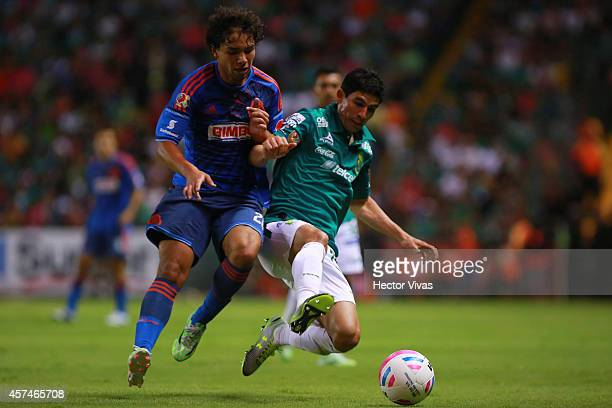 Jonny Magallon of Leon struggles for the ball with Giovani Hernandez of Chivas during a match between Leon and Chivas as part of 13th round Apertura...