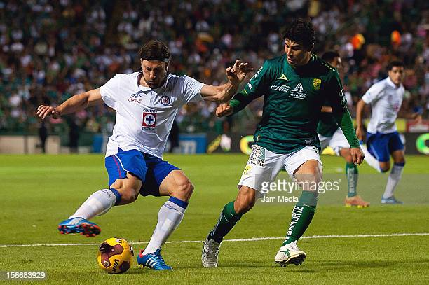Jonny Magallon of Leon struggles for the ball with Mariano Pavone of Cruz Azul during a quarter final match between Leon and Cruz Azul as part of the...