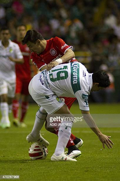Jonny Magallon of Leon vies for the ball with Edgar Benitez of Toluca during their Mexican Soccer Clausura 2015 tournament in Leon Guanajuato State...