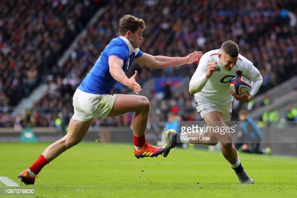 Jonny May of England beats Damian Penaud of France for the second try during the Guinness Six Nations match between England and France at Twickenham...