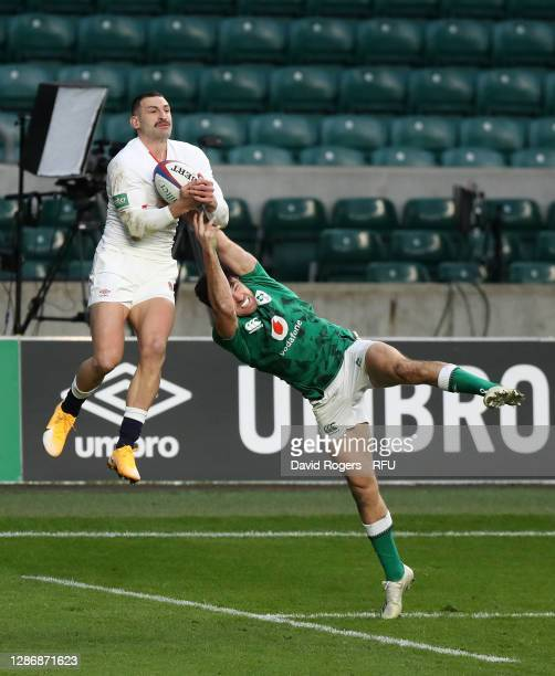 Jonny May of England beats Hugo Keenan of Ireland before going on to score their sides first try during the England v Ireland Quilter International...