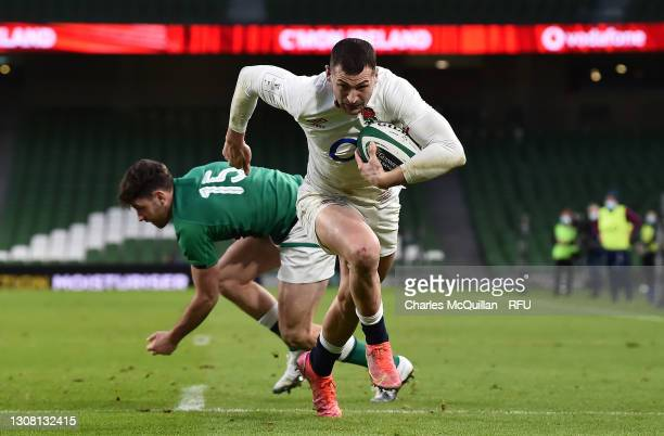 Jonny May of England beats Hugo Keenan of Ireland to go over and score their side's second try during the Guinness Six Nations match between Ireland...