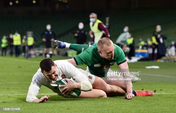 Jonny May of England beats Keith Earls of Ireland to go over and score their side's second try during the Guinness Six Nations match between Ireland...