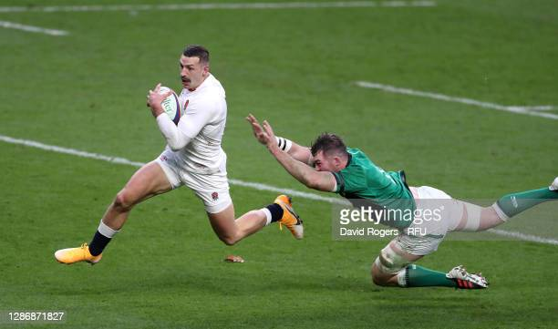 Jonny May of England beats Peter O'Mahony of Ireland to score their sides second try during the England v Ireland Quilter International match, part...