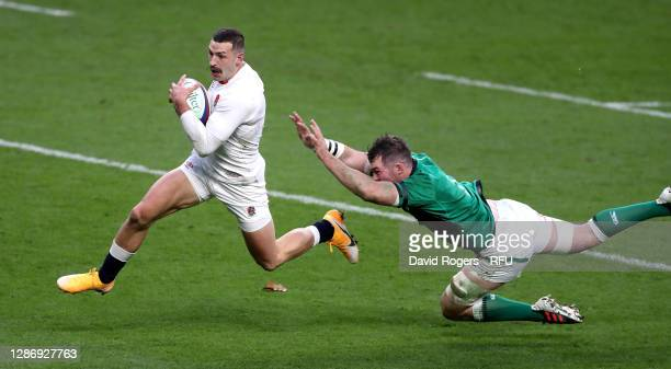 Jonny May of England beats Peter O'Mahony to score his and England's second try during the England v Ireland Quilter International match, part of the...