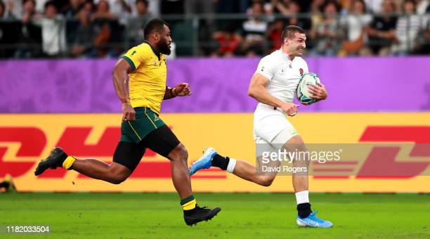 Jonny May of England breaks clear of Samu Kerevi to score a try during the Rugby World Cup 2019 Quarter Final match between England and Australia at...