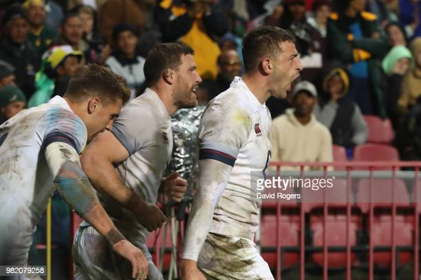 Jonny May of England celebrates after scoring a try during the third test match between South Africa and England at Newlands Stadium on June 23 2018...