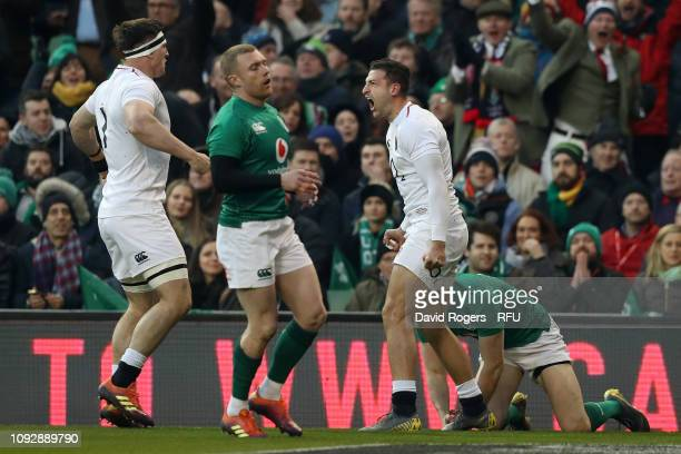 Jonny May of England celebrates scoring his sides first try during the Guinness Six Nations between Ireland and England at Aviva Stadium on February...