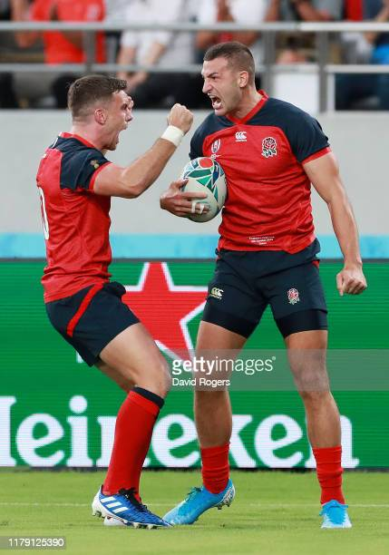 Jonny May of England celebrates scoring his side's first try with his team mate George Ford during the Rugby World Cup 2019 Group C game between...