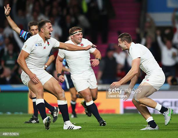 Jonny May of England celebrates scoring the first England try with Sam Burgess of England during the 2015 Rugby World Cup Pool A match between...