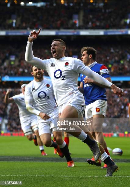 Jonny May of England celebrates scoring the first of his hatrick of tries during the Guinness Six Nation match between England and France at...