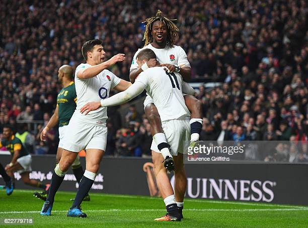 Jonny May of England celebrates scoring their first try with his team mates Ben Youngs and Marland Yarde during the Old Mutual Wealth Series match...