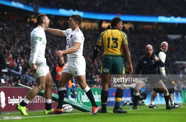 Jonny May of England celebrates with Ben Youngs of England after scoring the opening try during the Quilter International match between England and...