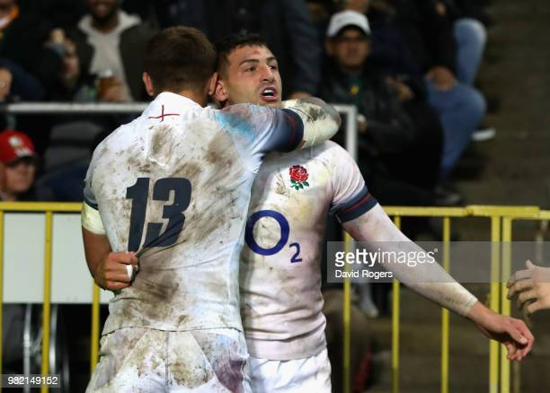 Jonny May of England celebrates with team mate Henry Slade after scoring a try during the third test match between South Africa and England at...