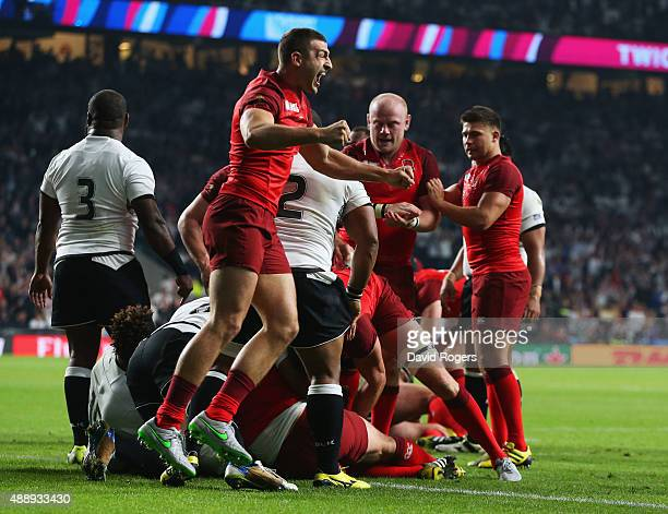 Jonny May of England celebrates with team mates after being awarded a penalty try during the 2015 Rugby World Cup Pool A match between England and...
